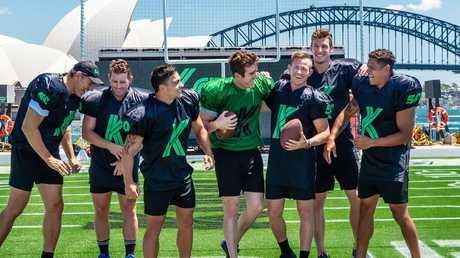 Dickson with some of Australia's biggest sport stars. Picture: Monique Harmer