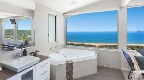Imagine splashing in the tub with a glass of champers right here.