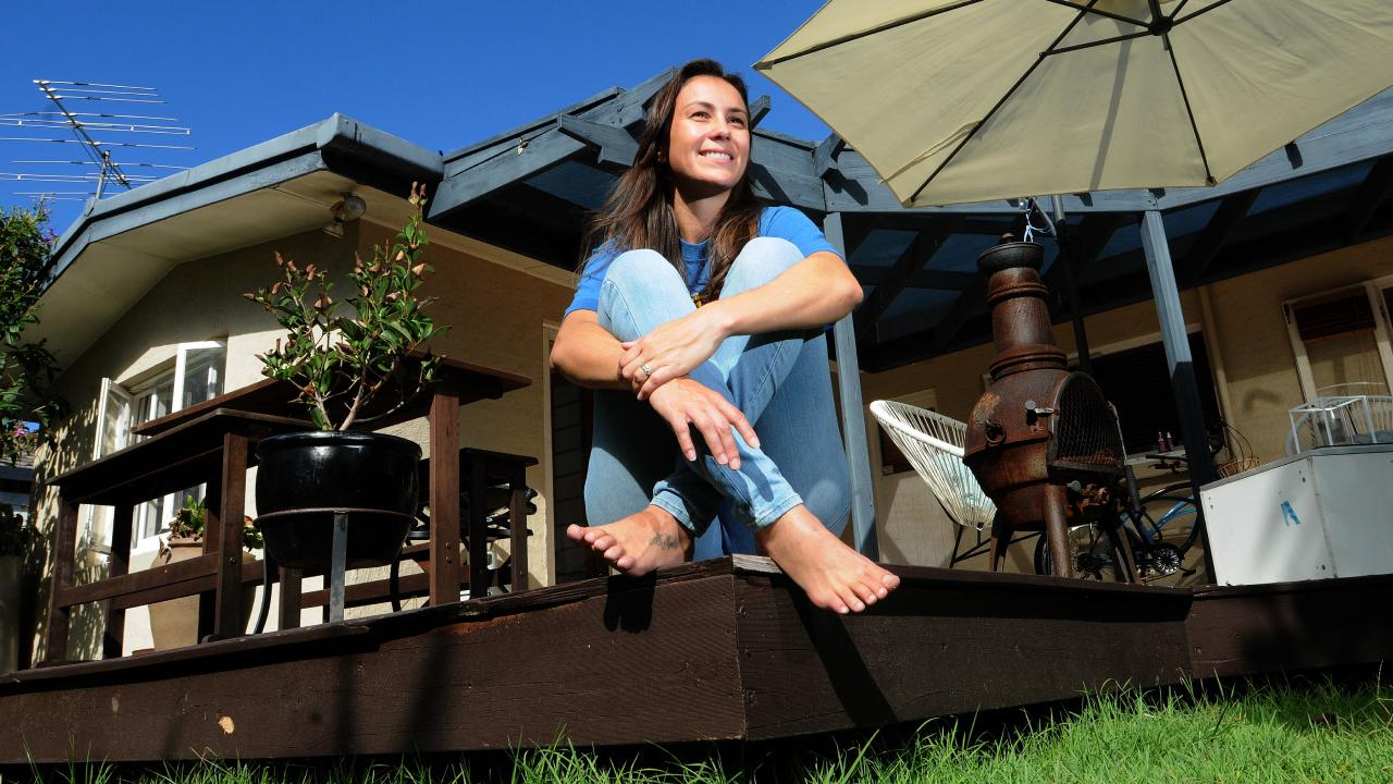Amy Billings on the deck of her old home on the Gold Coast. Picture: John Gass