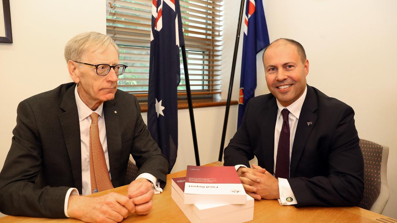 The banking royal commissioner, Kenneth Hayne, hands his report to the treasurer, Josh Frydenberg. Picture: Kym Smith/AAP