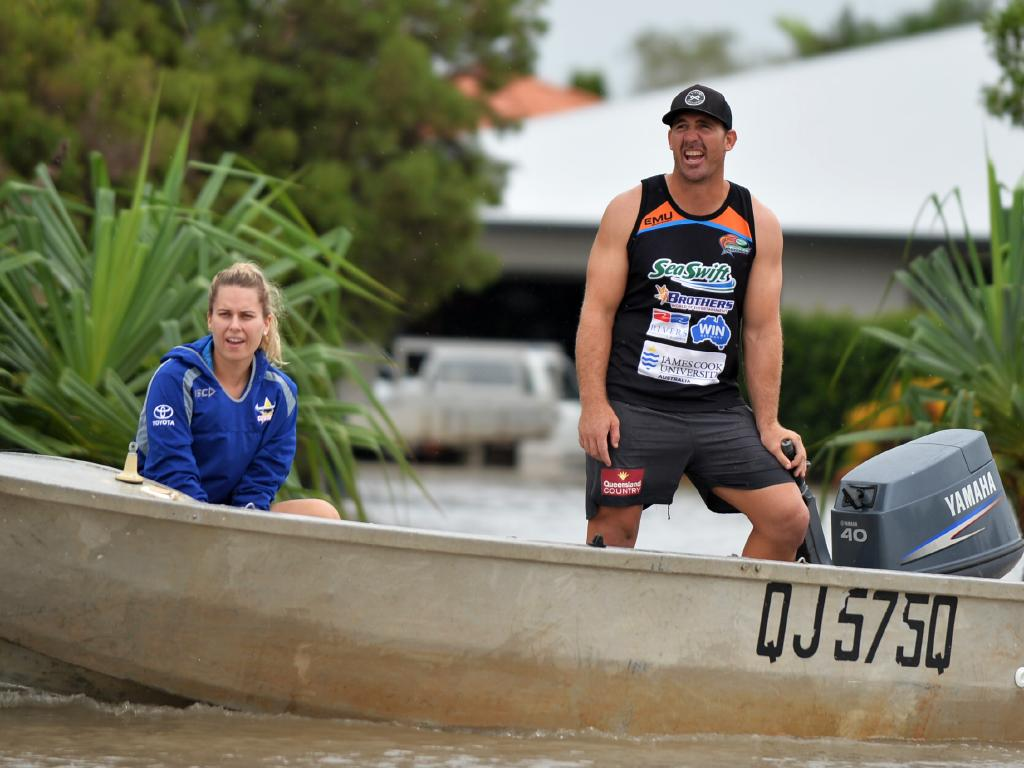 Townsville Floods.North Queensland Cowboy player Scott Bolton helps get residents out of Idalia. Picture: Alix Sweeney