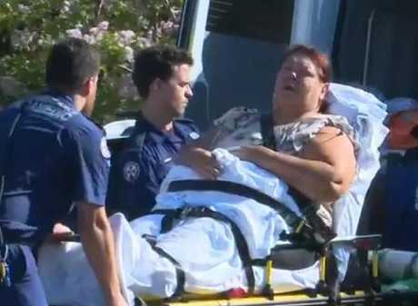 A woman, believed to be the boy's grandmother, is wheeled away by paramedics.