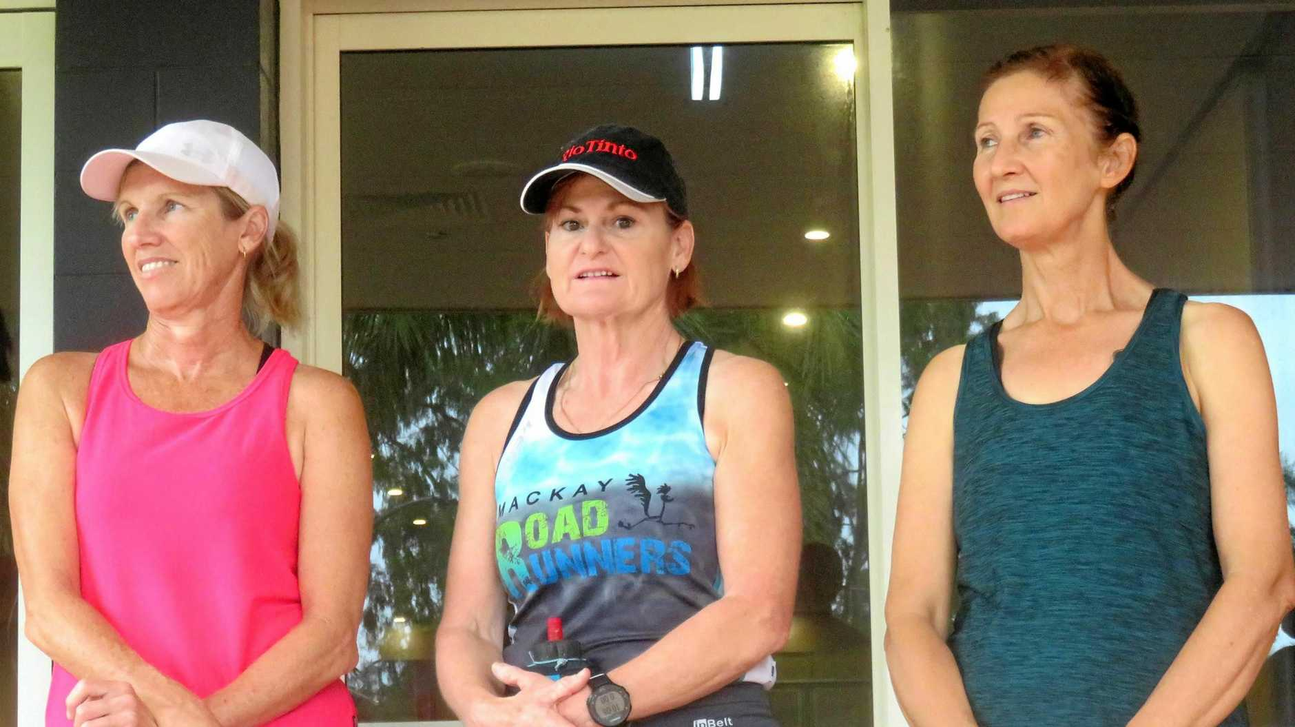 Mackay Road Runners Club secretary Glynis Forse (left) catches up with Jo Skinner(centre) and Hannah Allen pre-race.