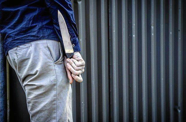 A home invader threatened to kill a woman's ex-partner with a large knife.
