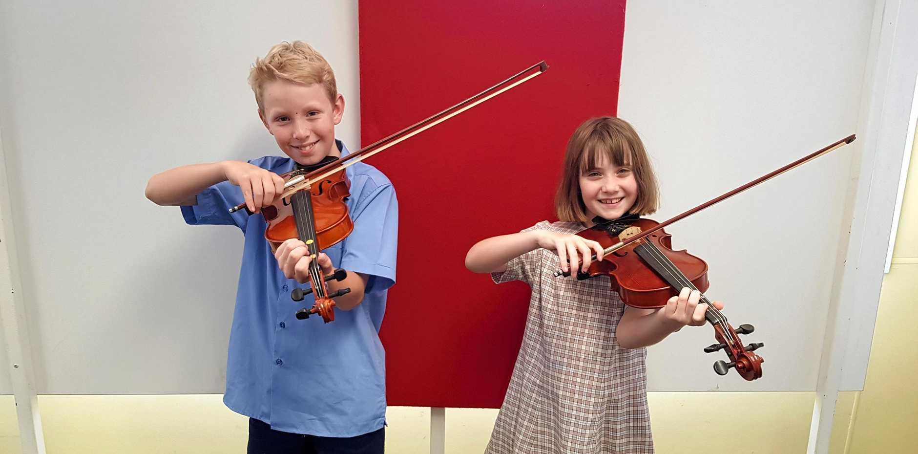 SWEET SYMPHONY: St Mary's Catholic School students Finn Clarke and Taya Sallur play some tunes.