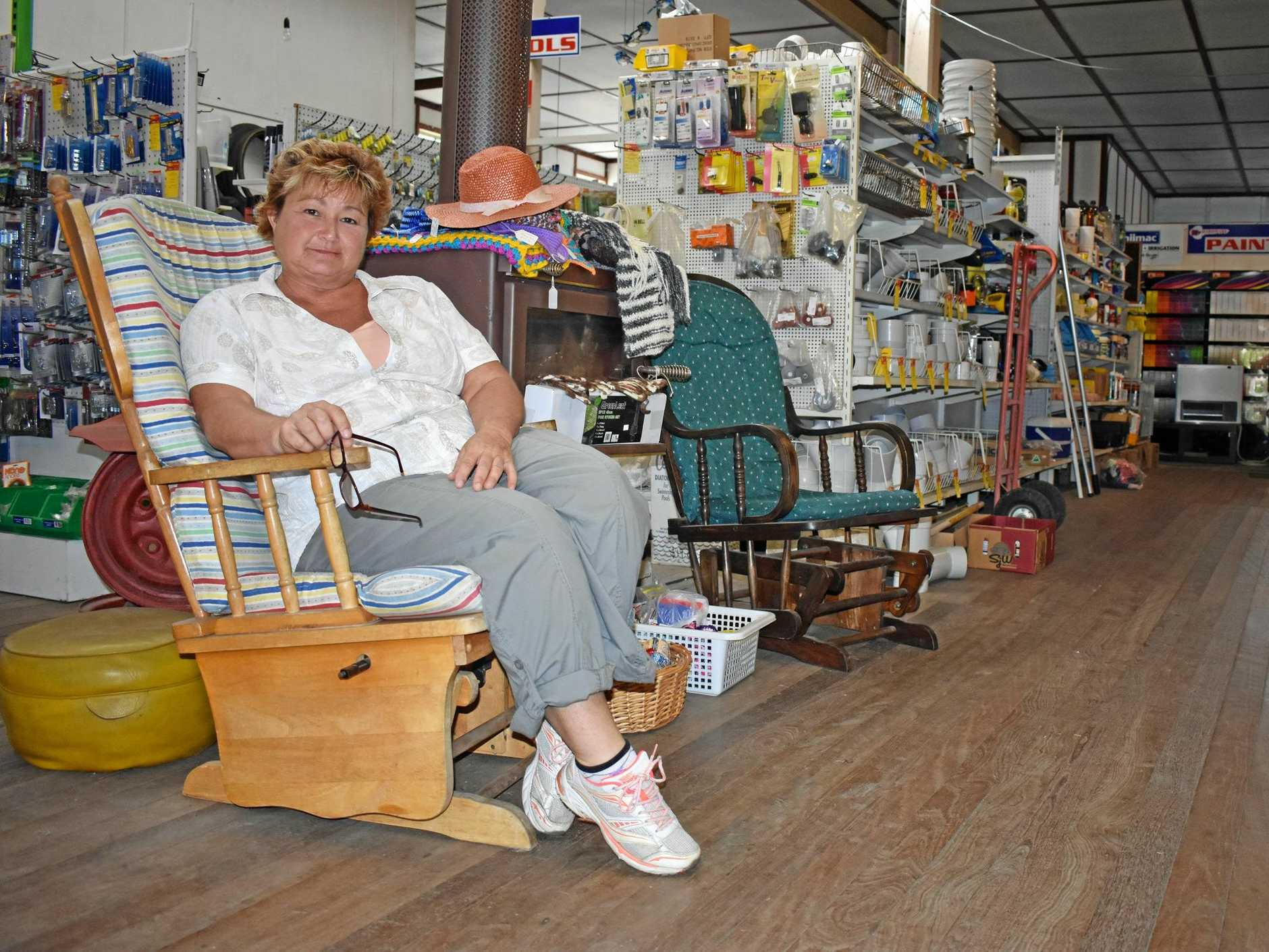 GOOD COUNTRY SERVICE: Bonalbo Hardware and Rural Store staff member Kate Campbell on the rocking chairs provided for elderly customers to wait while their orders are made up. The hardware store is for sale. INSET: One of the old orders found in the office.