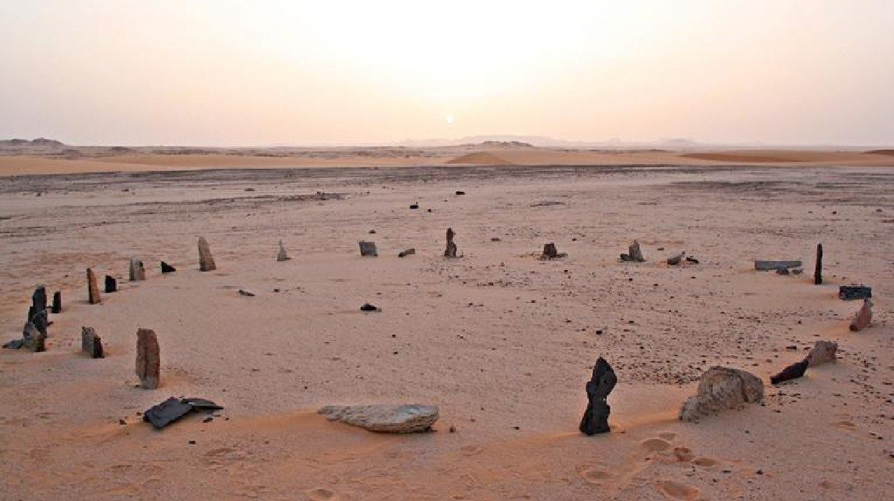 A circle of stones sits in a dusty plain of the western Sahara. Source: Supplied