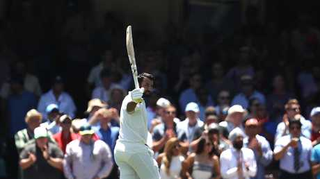 India's Cheteshwar Pujara raises his bat as he leaves the ground after being dismissed for 193 runs against Australia. Photo: Ryan Pierse/Getty Images.
