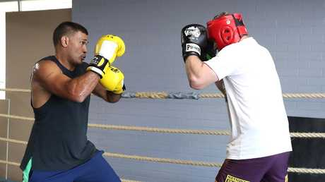 Justin Hodges spars ahead of his boxing debut. Picture: Peter Wallis
