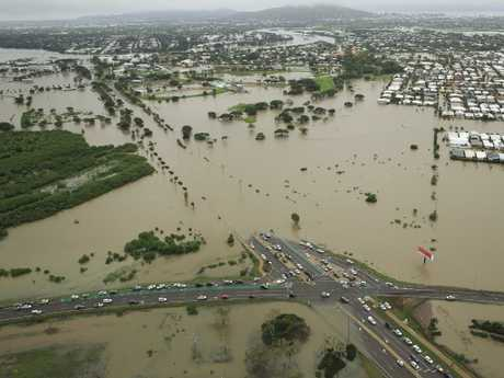 Stranded vehicles are seen from above as floodwater engulfs the intersection of Stuart Drive and the Bruce Highway in Townsville on February 4. Picture: Andrew Rankin/AAP.