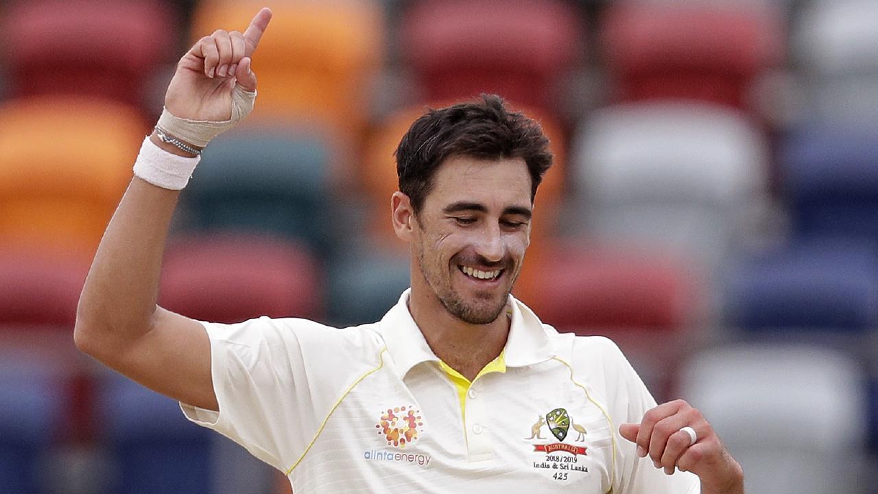 Australia's Mitchell Starc celebrates his 10th wicket against Sri Lanka. Photo: Rick Rycroft/AP Photo.
