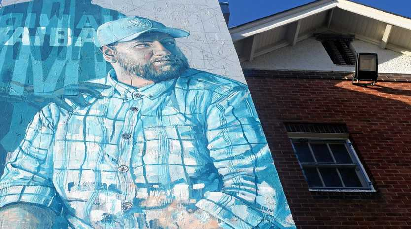 STUNNING: Renowned street artist Fintan Magee has painted a large-scale mural on Lismore Library. (The mural was unfinished at publication on Tuesday)
