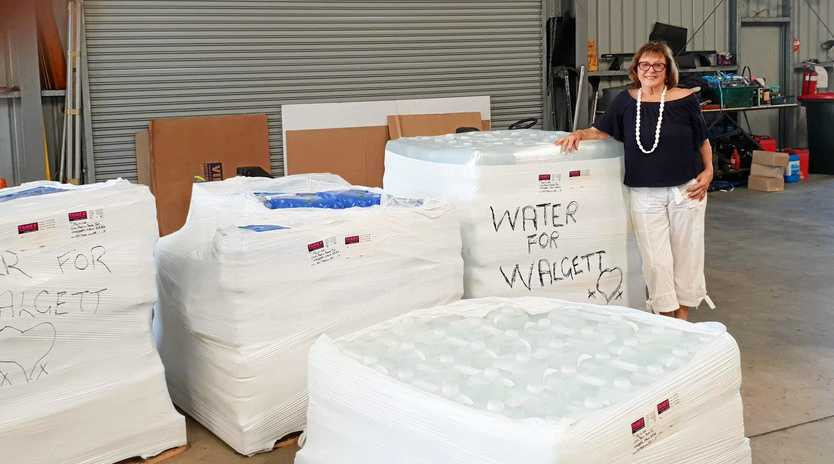 GENEROSITY: 3000 litres of donated fresh drinking water was sent out west to Walgett last month.