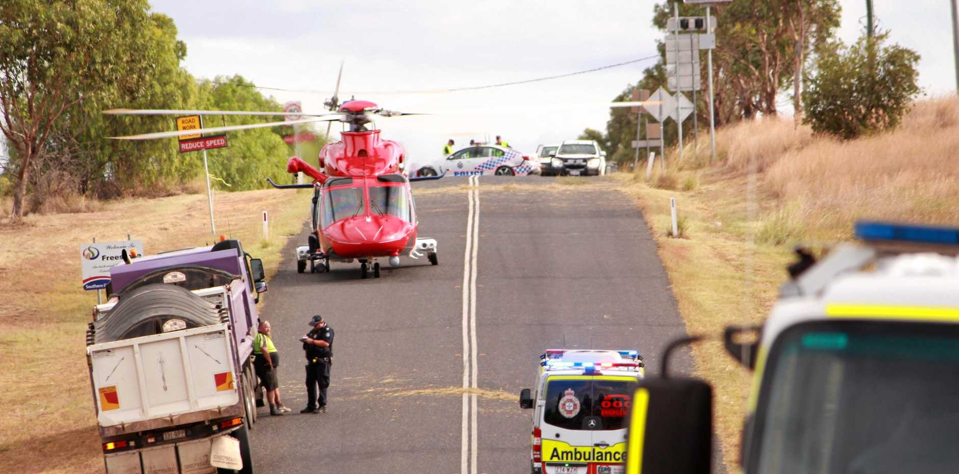 First responders worked to free a 29yo Brisbane man from his truck after a serious crash at Palmer Bridge in Freestone.