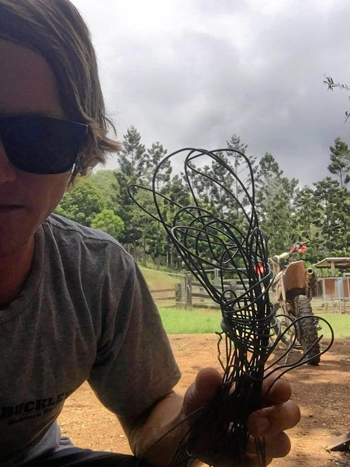 LOOKING ON THE BRIGHT SIDE: Ben Bird holds the wire that could have decapitated him if he had been riding faster when he ran into it in the forestry.