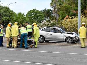 Man trapped after crashing into light pole