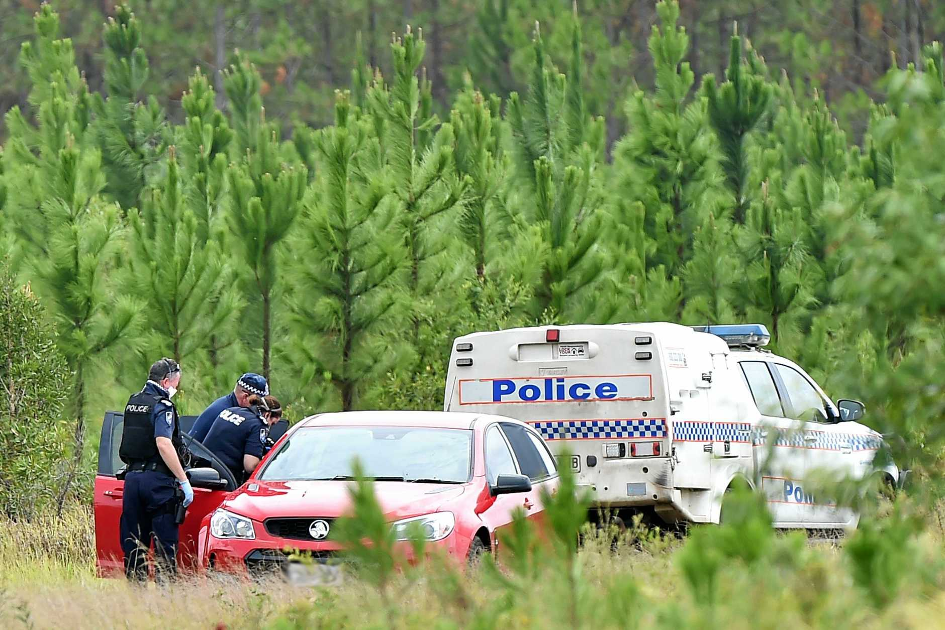 Two bodies have been found in a red car at Roys Road, Coochin.