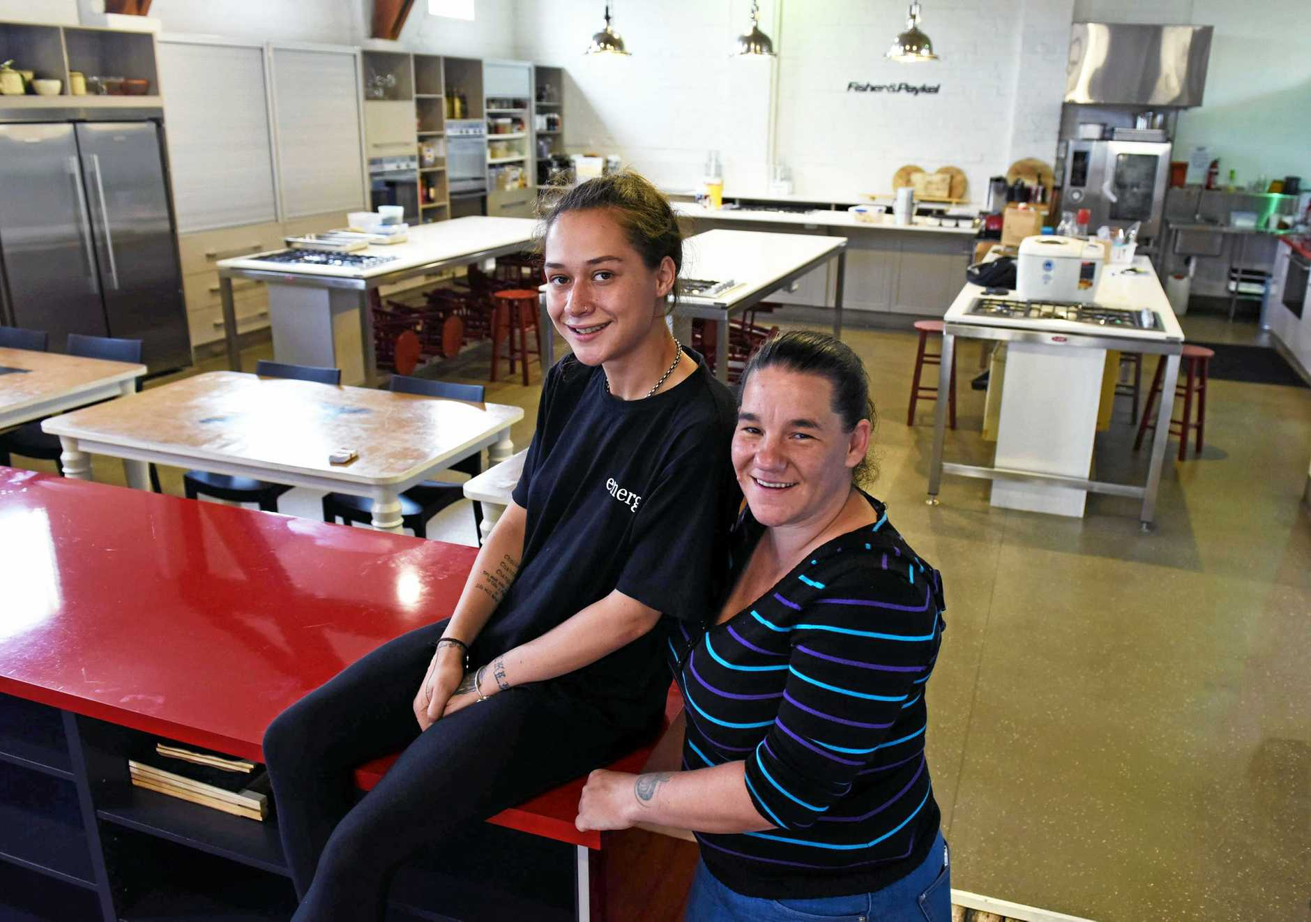 THE SAUCE: Moana Flynn (left) and Emerge managing director Jen Shaw prepare the new cafe for its Monday opening.