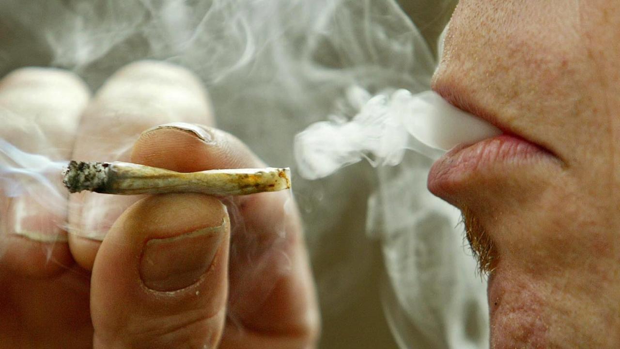 A man smokes marijuana.