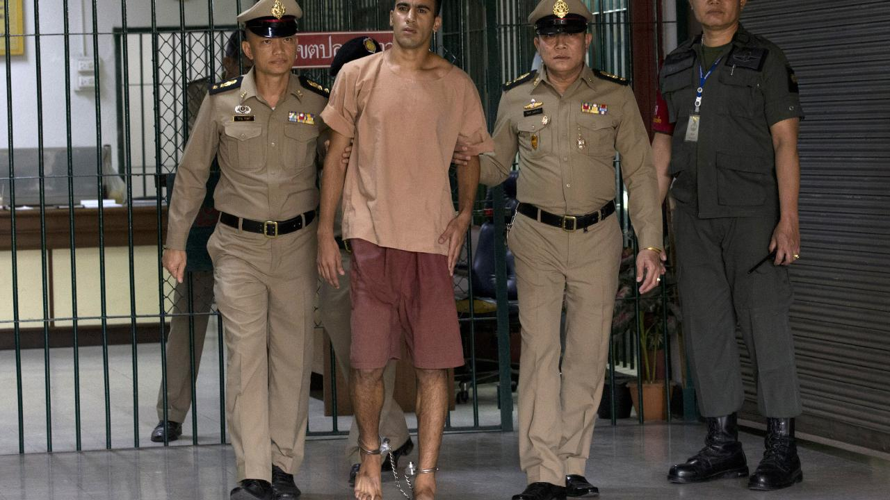 The Bahraini football player here is pictured leaving the criminal court in Bangkok on Monday. Picture: Sakchai Lalit