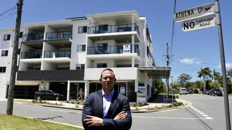 Housing and Public works Minister Mick de Brenni outside the Springwood units which triggered the inquiry into the failed Cullen Group.