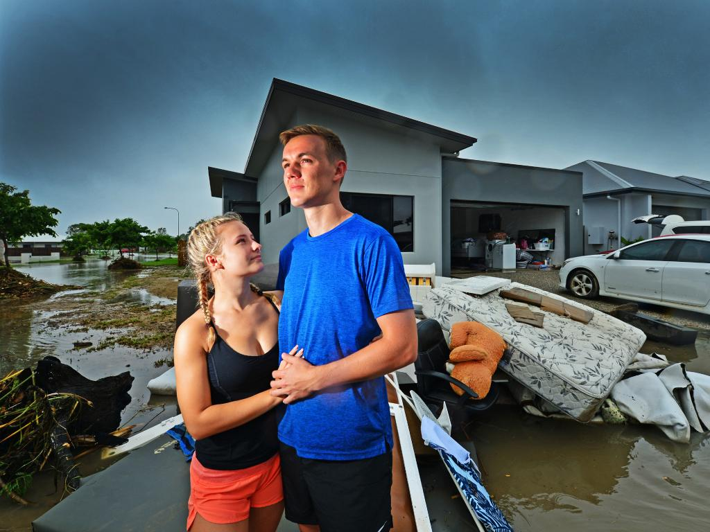Newly engaged couple Hope Roncato and Jake Perry in front of the home they just built on Tournament Drive, Rosslea. Picture: Zak Simmonds