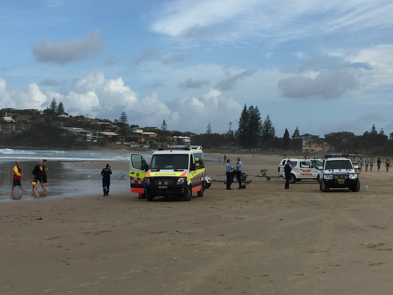 A 27-year-old man is missing in the surf on Woolgoolga Beach, after a 21-year-old woman was rescued this afternoon.