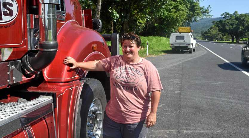 Steven Sternberg pilot driver Caz Rixon near the Mack with her vehicle in the baackground.