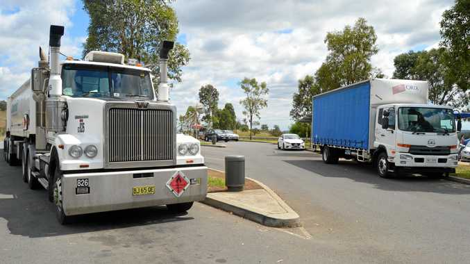 Two trucks and cars parked at the NSW rest area named in honour of a VC winner. Photo Alf Wilson / Big Rigs
