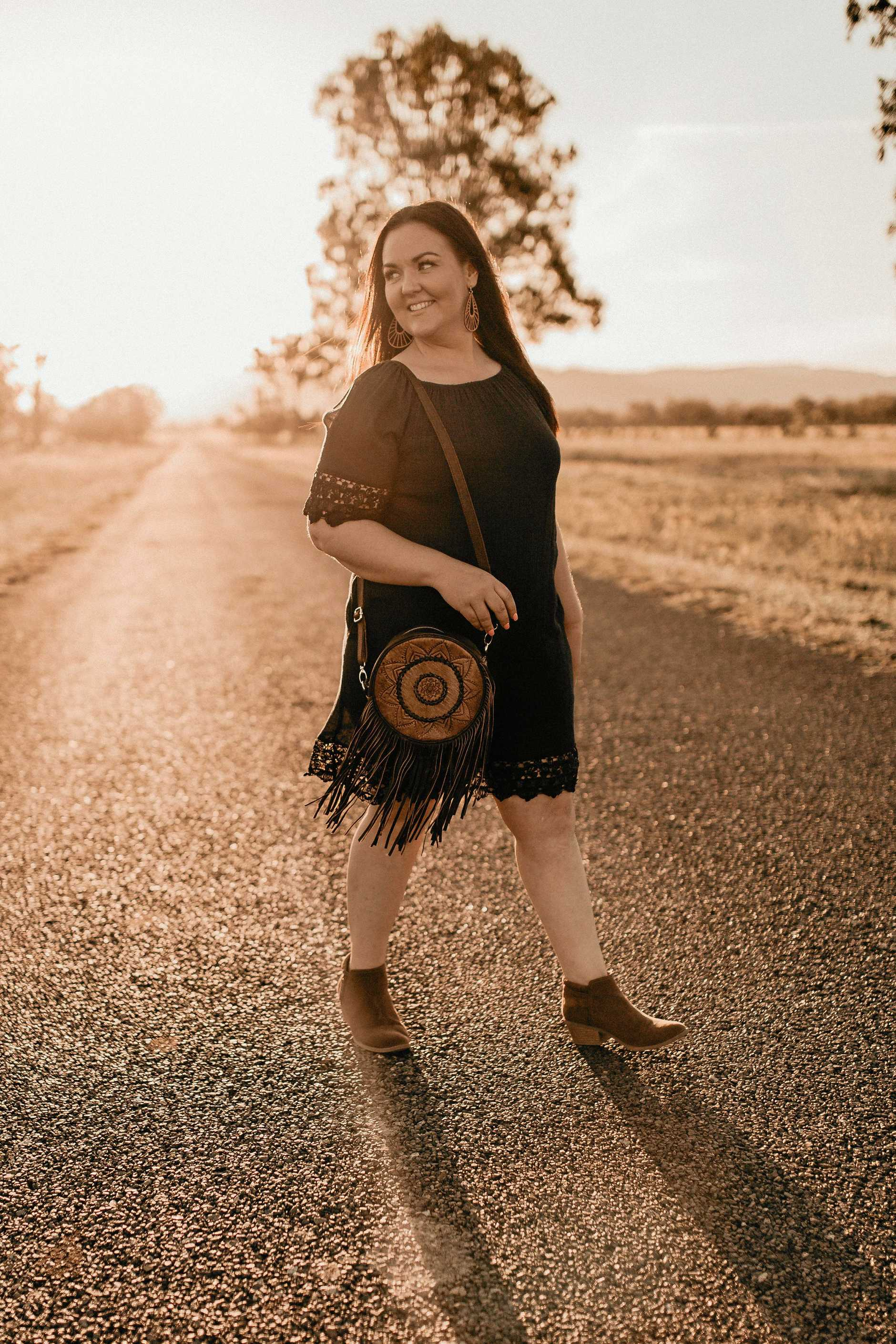 Country Allure founder Angela Taylor sports the 'Luna' round tassel bag.