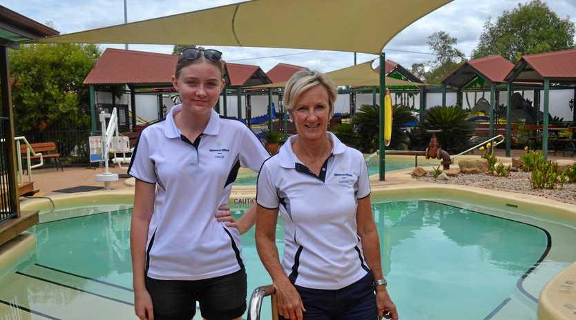 CHAMPAGNE SHOWERS: Mitchell Great Artesian Spa trainee Chloe Hosmer and supervisor Sandra Dobbin.