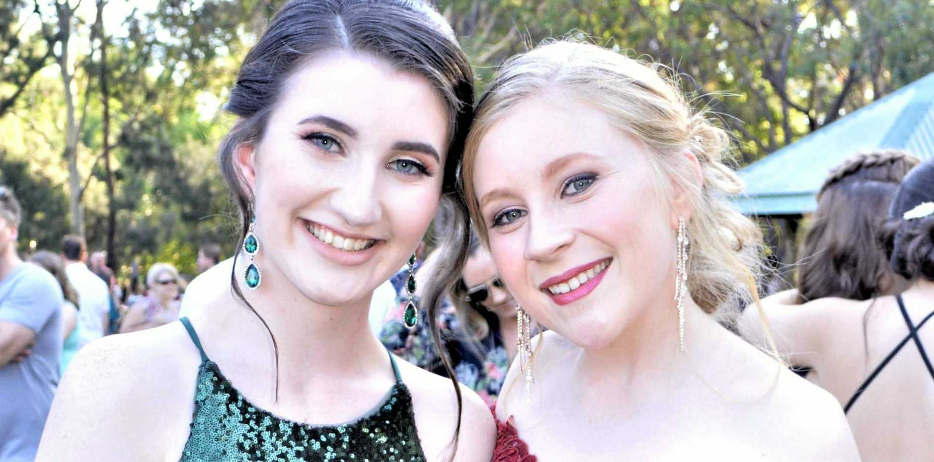PARTNERS IN CRIME: Former Kepnock State High School students Renee Nielsen and Hollie Cooper will take their mutual interest in true crime documentaries to the next level when they start university together.