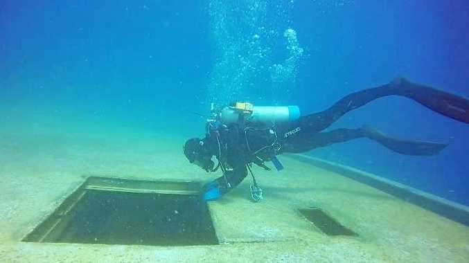 UNDER THE SEA: Photos reveal what the Tobruk looks like as she rests on the sea floor. INSET: Minister for Environment Leeanne Enoch and Fraser Cost Mayor George Seymour