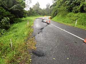 Huge cracks form in major road as region drenched