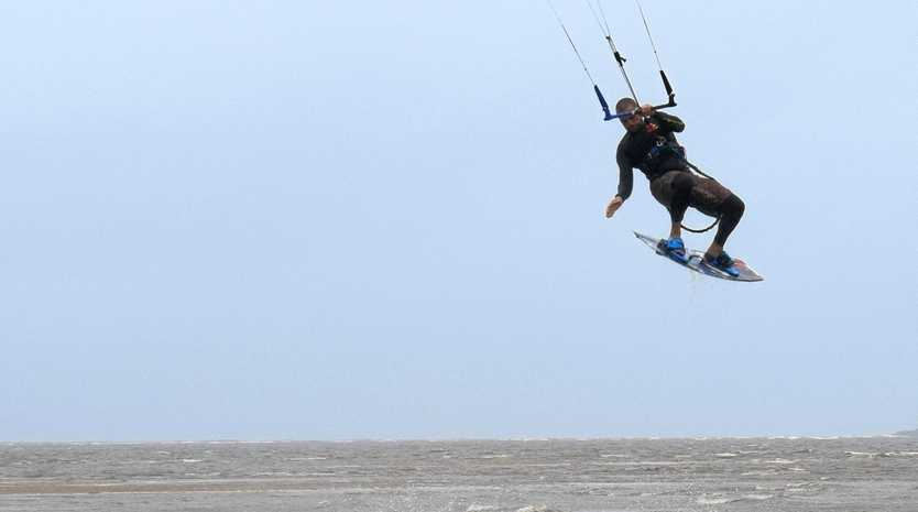 BLOWING A GALE: Kite boarders take advantage of the windy weather at Town Beach.