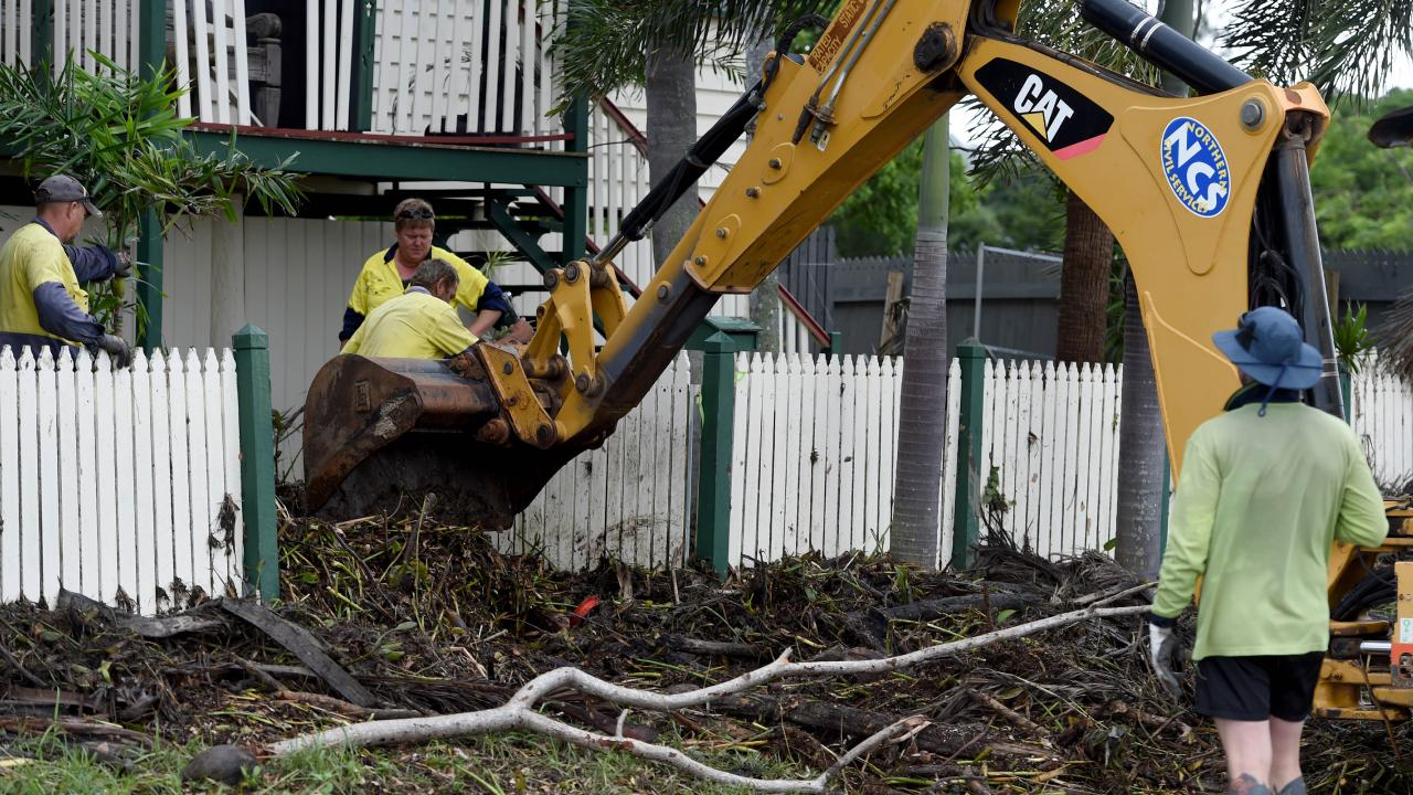 Flood debris is cleared from a home in Carmody St, Hermit Park. Picture: Evan Morgan