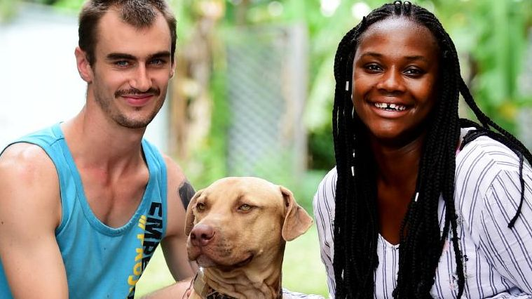 Michael Dorman and Mariam Fornah helped rescue King from a shed during the Townsville floods. Picture: Alix Sweeney