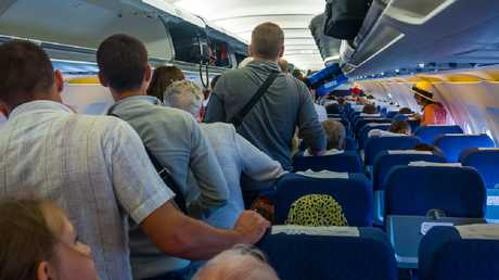 When it comes to enjoying a bit of personal space on planes, the struggle can be seriously real. Picture: iStock
