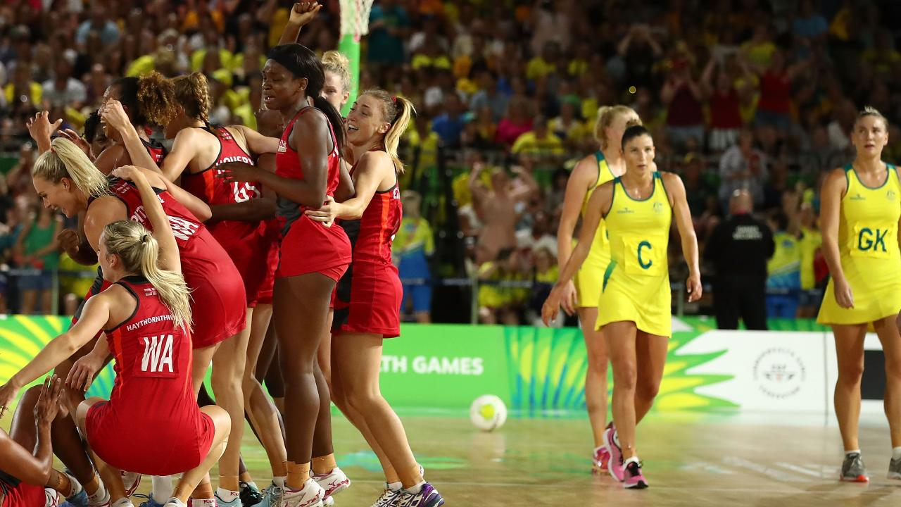 Diamonds players watch on in disappointment as England players celebrate winning the gold medal at last year's Commonwealth Games. Picture: Scott Barbour/Getty Images
