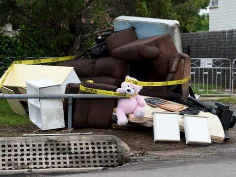 Flood debris piled up in Queens Rd, Hermit Park. Picture: Evan Morgan