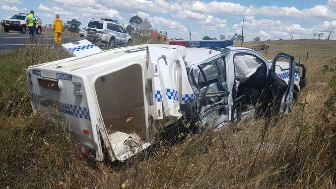 Two NSW police officers were injured and a paddy wagon written off after an accident on the Mitchell Highway in western NSW. Picture: NSW Police
