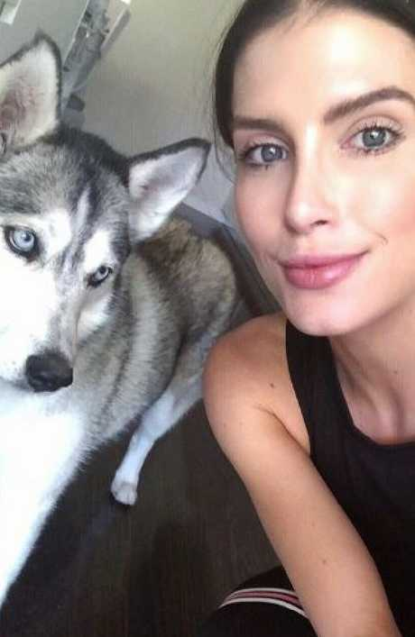 Erin Holland shares a snap with her adorable husky — showing off her flawless complexion.