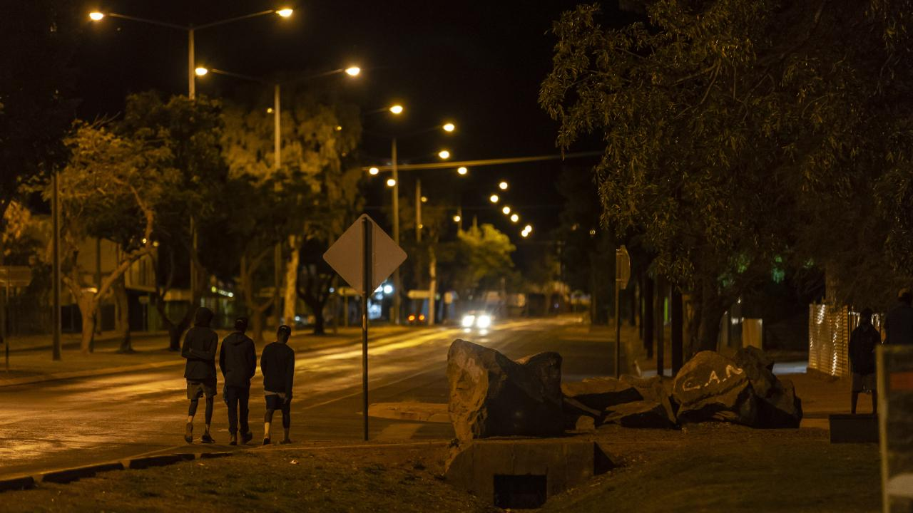 Youths walk the streets of Tennant Creek.