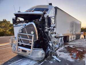 Crash between two semis closes New England Highway