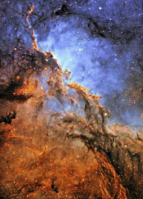IN COMBAT: Mr Campbell's photo 'The Fighting Dragons of Ara' captures a star forming combination of bright and dark nebulae, sculpted by massive, young stars that had recentlyformed there.