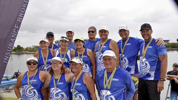 SUCCESS: Club Whitsunday Outriggers team with their medals at Lake Kawana.