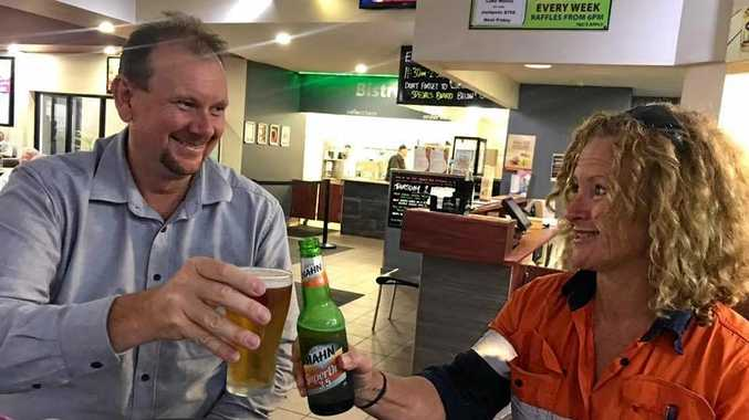 CELEBRATE: Russell Robertson and Catherine Weatherall celebrate Catherine's victory over  her bank.