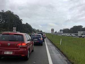 Truck and car crash grinds Bruce Highway to halt