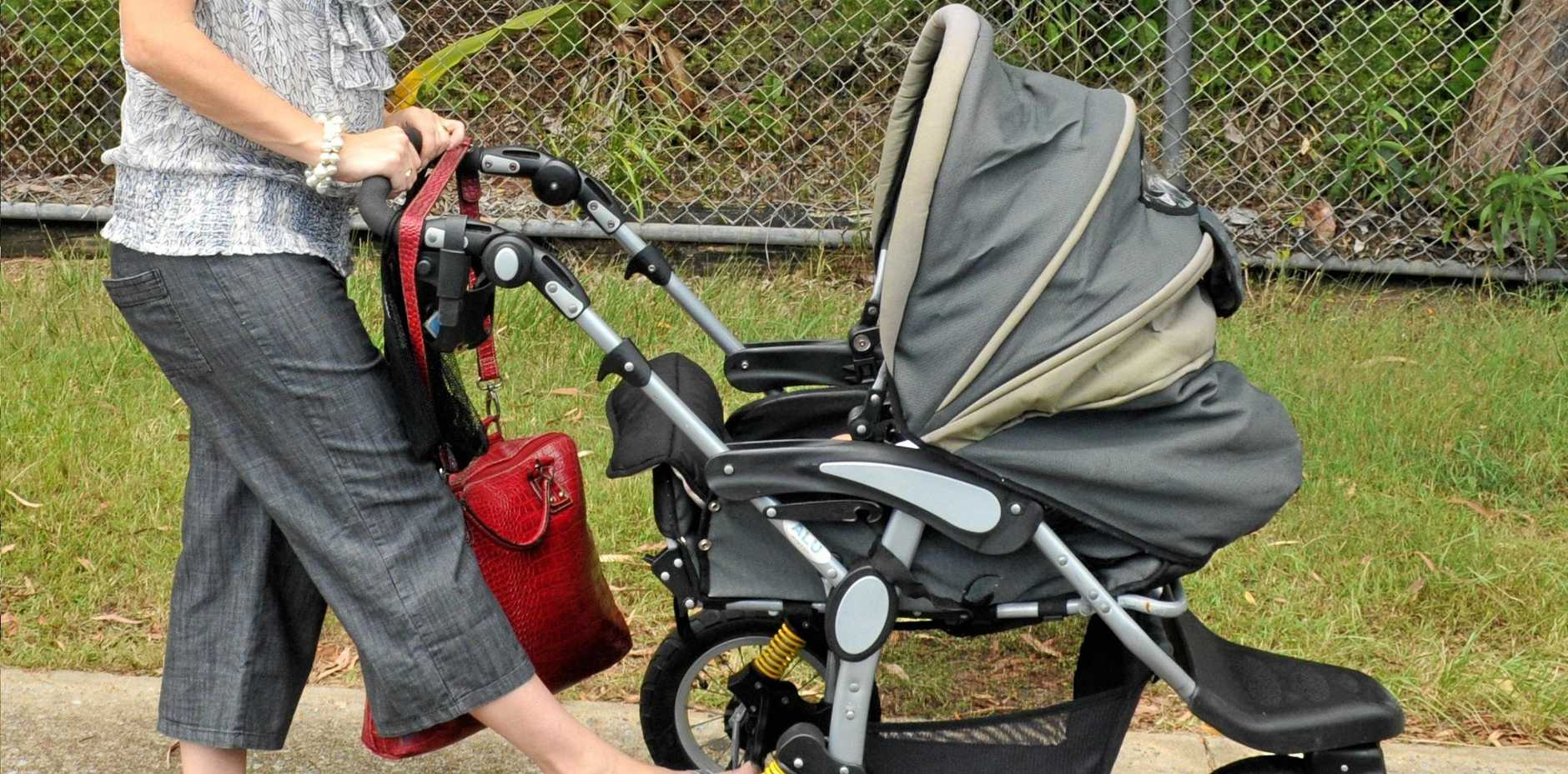 A woman walking with a friends baby in a pram was approached by men behaving erratically.