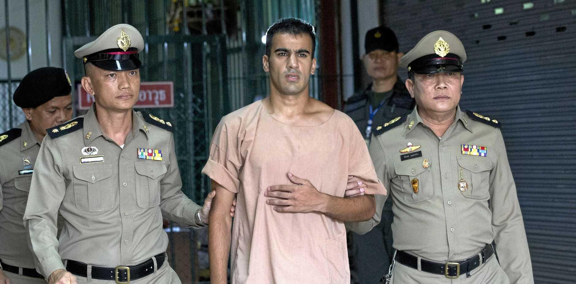Australian refugee Hakeem al-Araibi (centre) leaves the criminal court in Bangkok, Thailand.